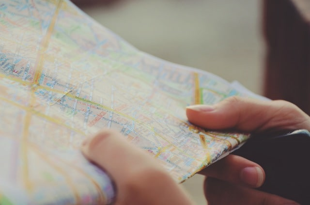 Person holding map and considering offer in compromise alternatives